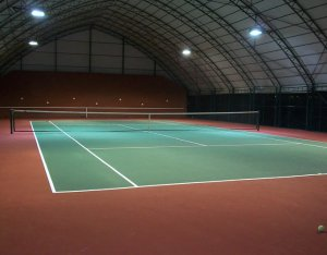 Indoor tennis court with SBR rubber roll covered with acrylic materials for sports surfaces, thickness 6mm