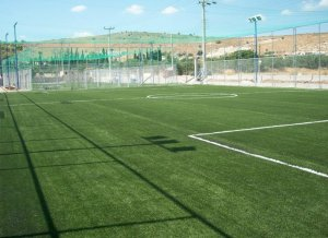 Artificial grass for soccer fields with shockpad