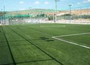 Συνθετικός χλοοτάπητας γηπέδου ποδοσφαίρου με αντικραδασμικό