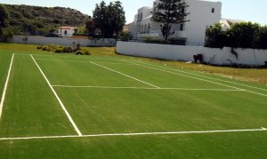 Tennis court with artificial turf ITF