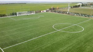Construction of soccer field with artificial turf